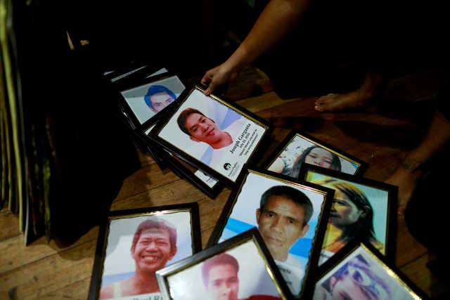 Framed portraits of Philippines' drug war victims are prepared for the theatre performance of grieving families on their journey of loss and healing in a Catholic school in Makati City. REUTERS/Eloisa Lopez