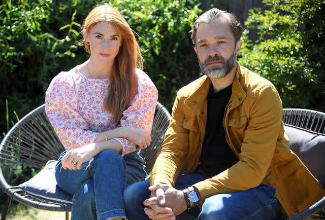 Wife and husband actors, Rosalie Craig (L) and Hadley Fraser, unable to perform in lead roles in the West End musical 'City of Angels', following the outbreak of the coronavirus disease, sit for a portrait in their garden in London, Britain. REUTERS/Toby Melville